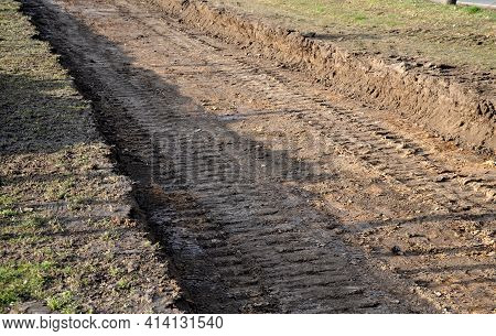 Preparing A New Path By Removing A Layer Of Soil. The Space Will Be Filled With Stones And Gravel. A