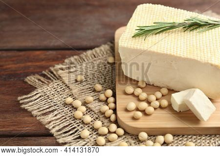 Delicious Tofu With Rosemary And Soy On Wooden Table, Closeup. Space For Text