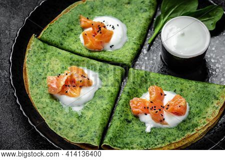 Green Spinach Crepes Or Pancakes With Smoked Salmon And Sour Cream. Vegetarian Food, Banner, Menu Re