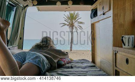 Vanlife, The girl is in the van watching the ocean