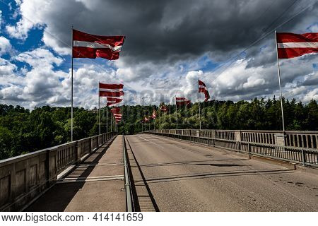 The Bridge Across The Gauja River Decorated With The National Flags Of Latvia.sigulda City .latvia