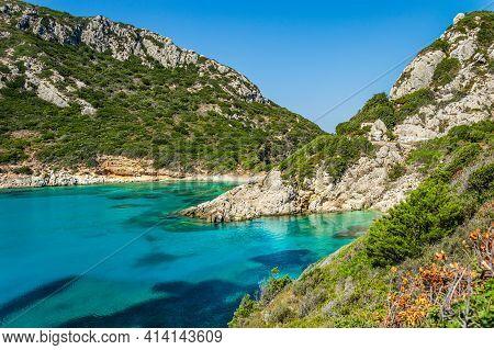 Porto Timoni Beach On Corfu Island In Greece. Beautiful View Of Green Mountains, Clear Sea Water, Se