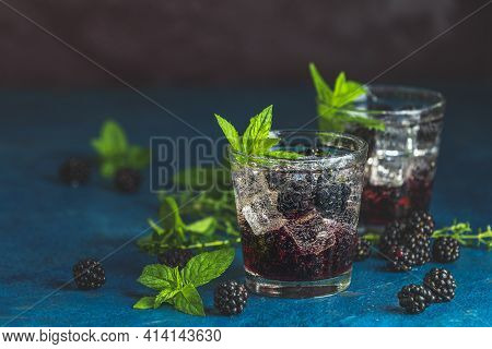Cold Summer Berry Drink With Blackberries. Refreshing Summer Drink With Syrup, Blackberry And Ice On