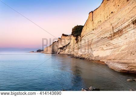 Logas Sunset Beach With Sheer White Cliffs In Peroulades Village On Corfu Island In Greece. Loggas I