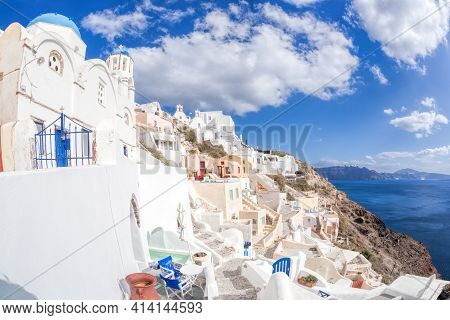 Oia Village With Churches And Old Houses On Santorini Island In Greece