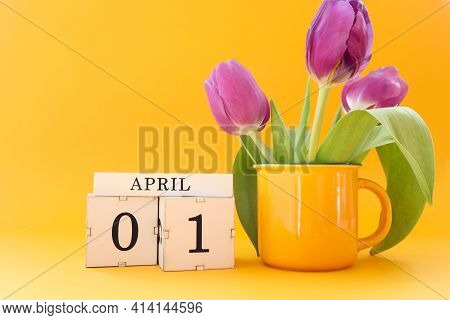 Calendar For April 1: Cubes With The Numbers 0 And 1, The Name Of The Month April In English, A Bouq