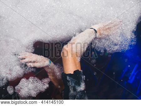 Hands Of A Man Play With Foam At A Foam Party In A Nightclub.