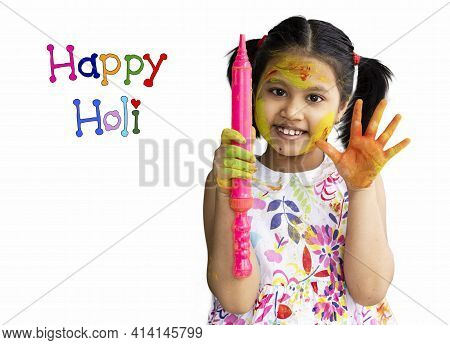 A Cute Indian Girl Child Showing Colorful Palm And Water Gun During Holi On White Background With Ha