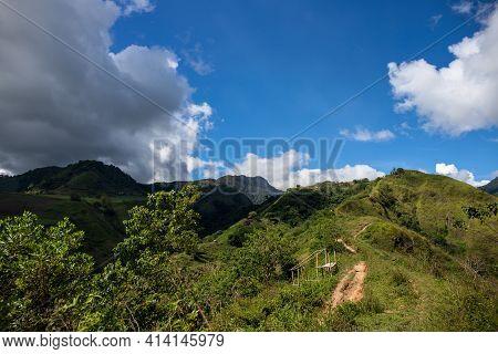 Green Mountain Range And Walking Path Under Blue Sky Landscape. Rural Land Scenery. Summer Travel Hi