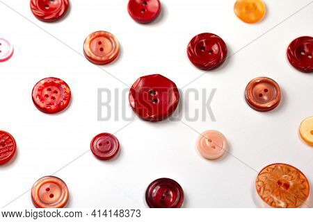 Colorful Red And Pink Buttons On A White Background. Set Of Red Buttons. Old Vintage Buttons Close U