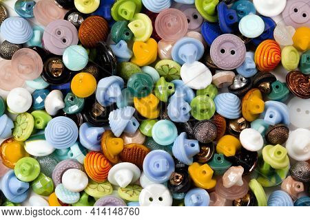 Colorful Bright Buttons Background. Old Vintage Buttons Close-up. Copy Space. Top View. Background O