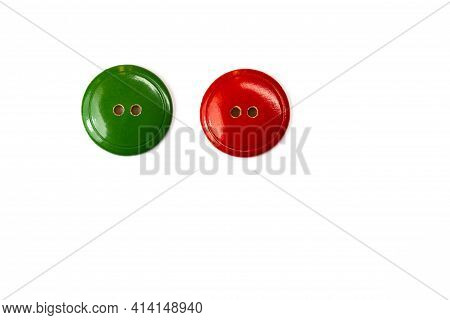 Red And Green Wooden Buttons On A White Background Close-up. Two Vintage Isolate Buttons For Cutting