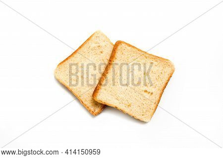 Two Slices Of White Bread Toast Isolated On White - Top View