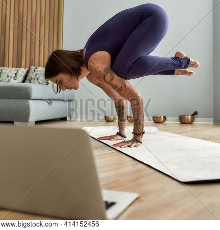 Young Girl Coach Standing In Her Arms. Girl Stands In Her Arms While She Conducting An Online Yoga C