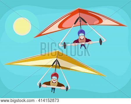 Hang Glider In Helmet And Uniform Soaring Thermal Updrafts Suspended On Harness Below The Wing. Smil