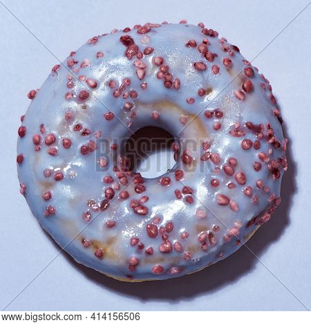 Favorite Doughnut Recipe. Close Up Shot Of A Freshly Baked Delicious Donut With Sprinkles And Sugar