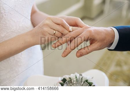 Wedding Day. The Bride's Hand Puts The Wedding Ring On The Groom. Happy Day. Wedding Ceremony. The M