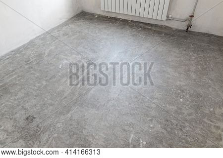 Prepared Concrete Floor In Empty Room For Pouring The Floor Covering With Self-leveling Mixture