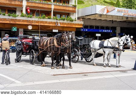 Zermatt, Switzerland - June 22, 2019: Horse Carriage Vehicle For Tourists Riding In Zermatt Town, Va