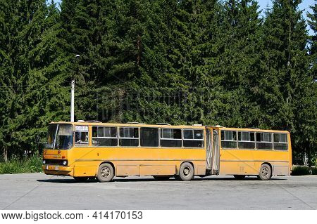 Revda, Russia - July 11, 2010: Yellow Articulated Bus Ikarus 280 In The City Street.