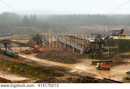Earth Mover Loading Dumper Truck With Sand In Quarry. Excavator Loading Sand Into Dumper Truck.quarr