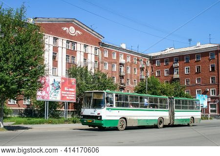 Revda, Russia - July 11, 2010: White And Green Articulated Bus Ikarus 280 In The City Street.