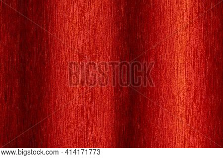 Close Up Photo Of Red Velvet Curtain With Curves Hung On The Wall