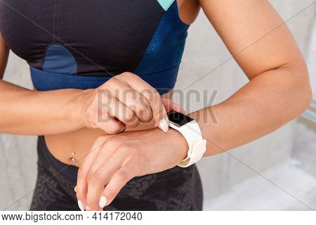 Close Up Shoot Of Woman's Hands With Fitness Bracelet. Sporty Woman Is Preparing For The Run.