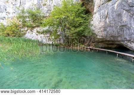 Plitvice Lakes National Park, A Miracle Of Nature, Beautiful Landscape With A Lake With Turquoise Wa