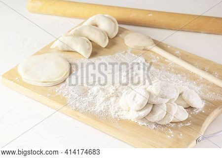 Blanks For Rolling Dough In Flour And Raw Manti, Dumplings, Or Wontons Of Dough Stuffed With Minced