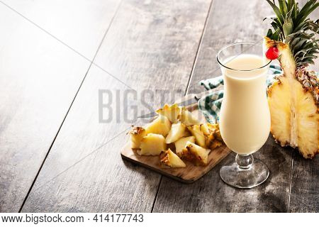 Pina Colada Cocktail In Glass On Wooden Table. Copy Space