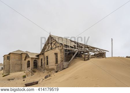 Namib Desert, Namibia - January 8.2021: Side View With Lot Of Sand To The Lehrer House At German Kol