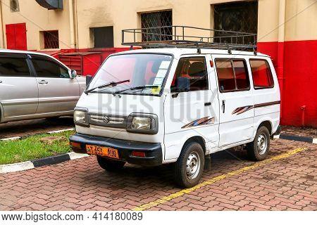 Arusha, Tanzania - February 8, 2021: White Microvan Maruti Omni In The City Street.