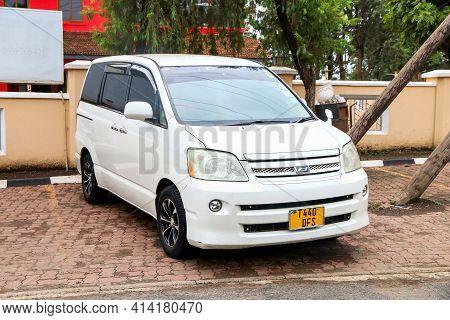 Arusha, Tanzania - February 8, 2021: White Minivan Toyota Noah In The City Street.