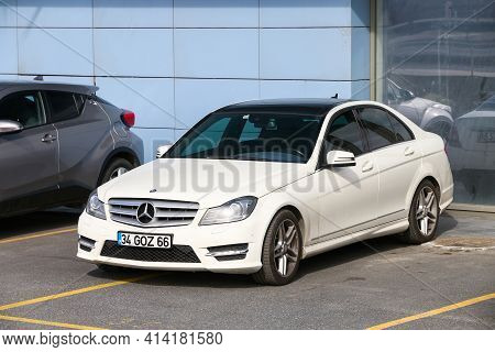 Istanbul, Turkey - February 11, 2021: White Sedan Mercedes-benz C-class (w204) In The City Street.