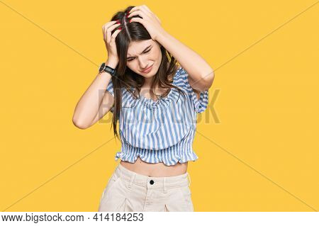 Young beautiful caucasian girl wearing casual clothes suffering from headache desperate and stressed because pain and migraine. hands on head.