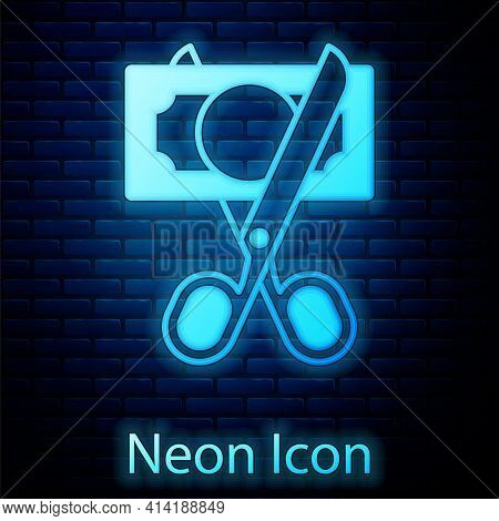 Glowing Neon Scissors Cutting Money Icon Isolated On Brick Wall Background. Price, Cost Reduction Or