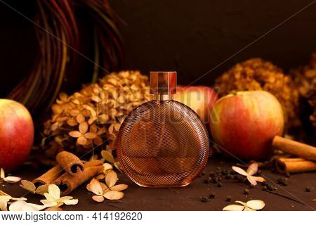 Unbranded Perfume Bottle, Apples, Cinnamon And Dry Hydrangea Flowers On Brown Background. Spicy Autu