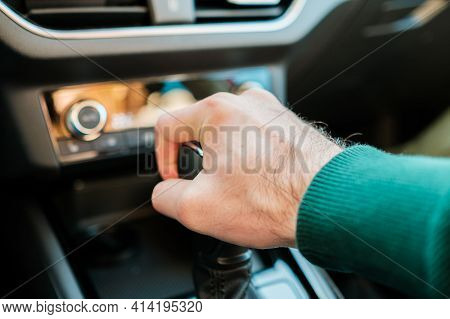 A Mans Hand Shifting Gearbox In The Modern Auto. Man Shifting A Stick Of A Manual Or Automatic Gearb