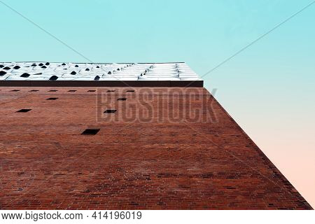 Hamburg, Germany - August 7, 2019: Low Angle View Of Elbphilharmonie Hamburg Against Pink An Blue Sk