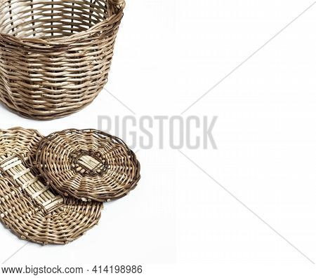 Wicker Basket And Bottoms For Baskets Isolated On White Background. Flat Lay. Weaving From A Vine Co