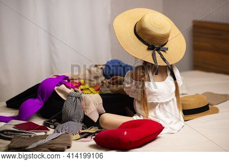 The Girl Is Packing Her Suitcases For A New Trip And A Long Weekend Trip, Vacation At The Sea, Wants