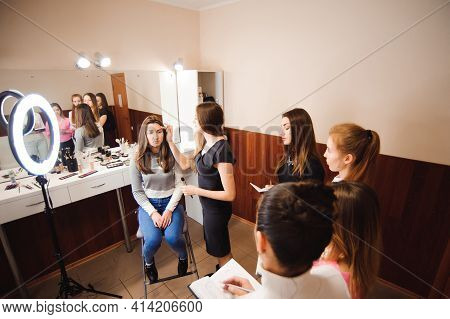 Makeup Teacher With Her Student Girls. Makeup Tutorial Lesson At Beauty School. Makeup Master Class.
