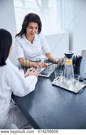 Spa Client Being Consulted By A General Practitioner