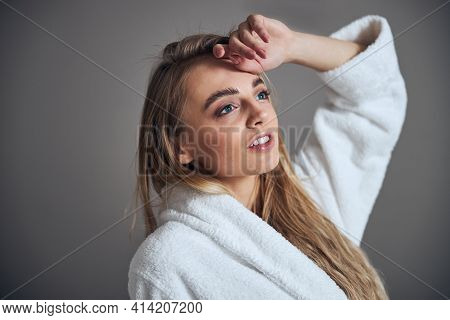 Gorgeous Woman Daydreaming Before A Spa Procedure