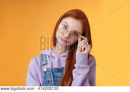 Annoyed Bossy Unimpressed Bothered Young Redhead Female Coworker Smirking Tilting Head Irritated Tou
