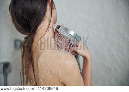 Slim Naked Woman Having A Relaxing Shower
