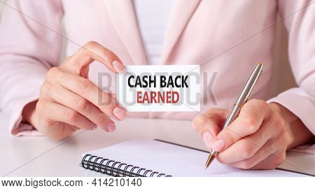 A Card In The Hands Of A Woman With The Inscription Cash Back Earned