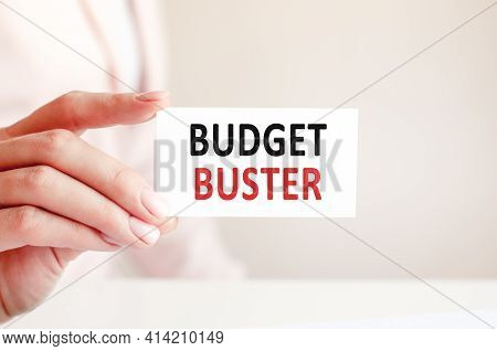 Budget Buster Written On A Paper Card In Woman Hand