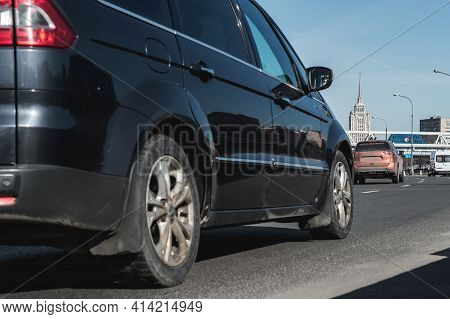 Moscow, Russia - March 2021: City Trafic On The Road. Part Of Black Minivan Car With Selective Focus